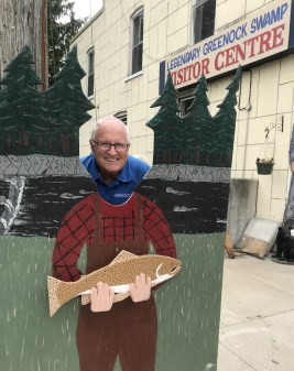 Mayor Inglis poses in a cut-out of historic village character